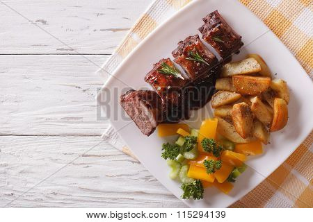 Bbq Pork Ribs With Vegetables On A Plate. Horizontal Top View