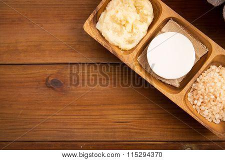 close up of soap, himalayan salt and body scrub