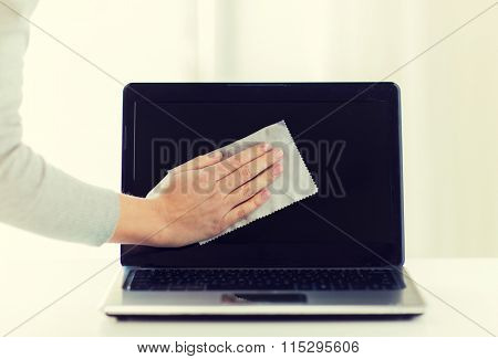 close up of woman hand cleaning laptop screen