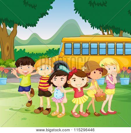 Children standing by the schoolbus illustration