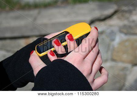 Girl Holding Yellow Gps Navigation