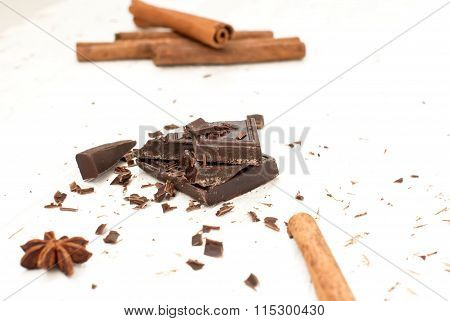 Pieces Of Dark Chocolate And Cinnamon Sticks
