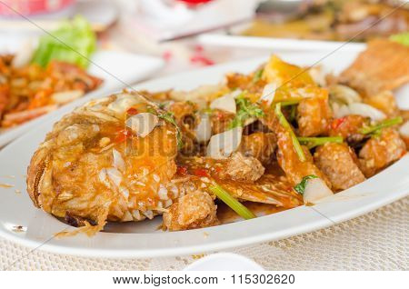 fried Red Tilapia on white plate