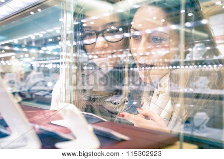 Young Beautiful Girlfriends At Jewelry Store - Best Friends Sharing Free Time Having Fun At Shopping