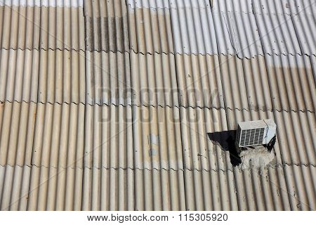 Old metal roof with air conditioner