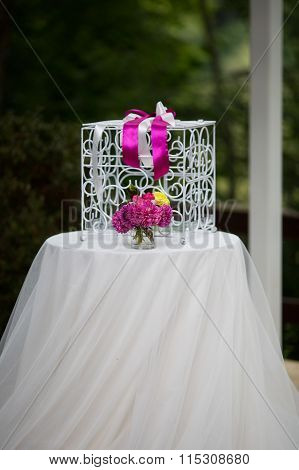 Vintage White Ornated Metal Cage At Wedding Aisle With Flowers In A Vase