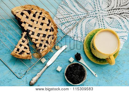 Homemade Sand Cake With Cherry Jam On A Lattice And A Cup Of Tea With Milk