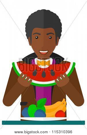 Man eating watermelon.