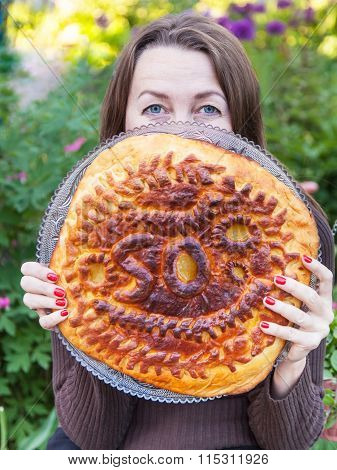 Woman Holds A Birthday Pie