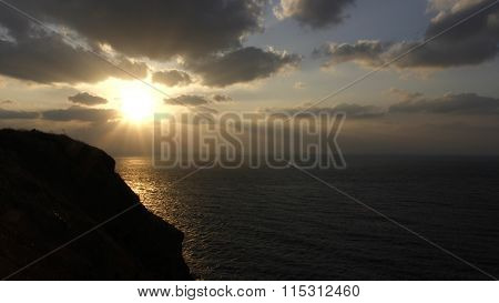 Sunset At Golden Time On Seashore With Dark Grey Cloudy