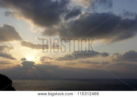 Sunshine Behind Cloud On Seashore With Blue Grey Sky