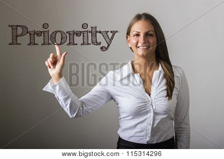 Priority - Beautiful Girl Touching Text On Transparent Surface