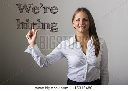 We're Hiring - Beautiful Girl Touching Text On Transparent Surface