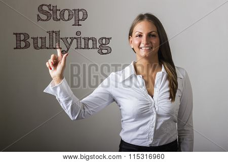 Stop Bullying - Beautiful Girl Touching Text On Transparent Surface