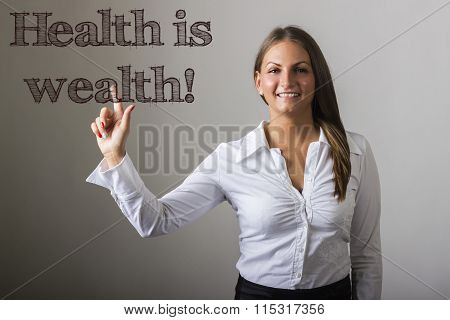 Health Is Wealth! - Beautiful Girl Touching Text On Transparent Surface