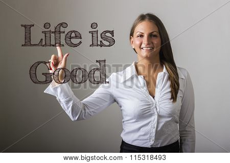 Life Is Good - Beautiful Girl Touching Text On Transparent Surface