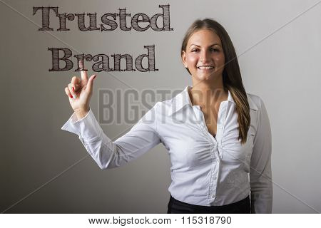 Trusted Brand - Beautiful Girl Touching Text On Transparent Surface