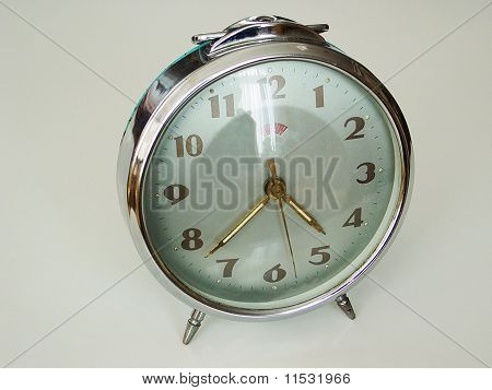 an old windup alarm clock