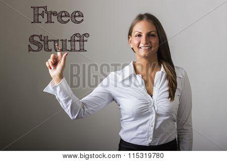 Free Stuff - Beautiful Girl Touching Text On Transparent Surface