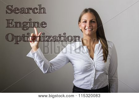 Search Engine Optimization - Beautiful Girl Touching Text On Transparent Surface