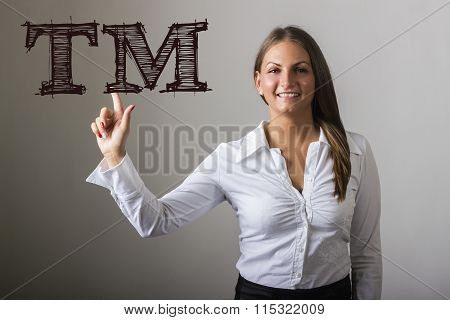 Tm Trade Mark  - Beautiful Girl Touching Text On Transparent Surface