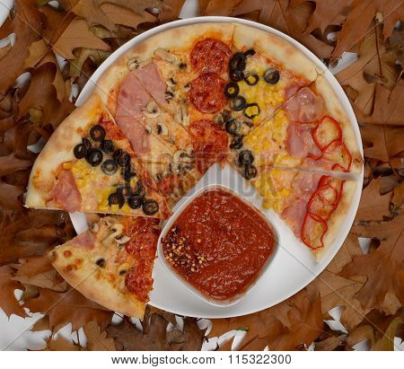 sliece of pizza with  ham, mushroom, olives, pepperoni, corn, bacon, red pepper and sauce on withere