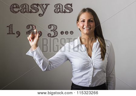 Easy As 1, 2, 3… - Beautiful Girl Touching Text On Transparent Surface