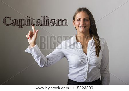 Capitalism - Beautiful Girl Touching Text On Transparent Surface