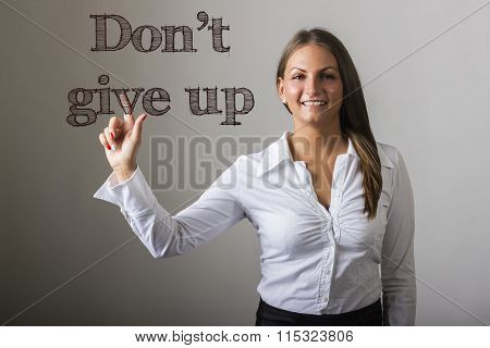 Don't Give Up - Beautiful Girl Touching Text On Transparent Surface