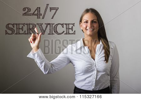24/7 Service - Beautiful Girl Touching Text On Transparent Surface