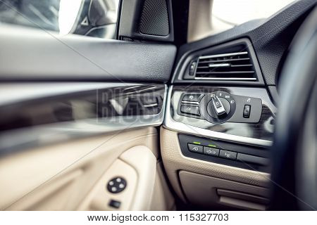 Modern Car Interior With Leather And Premium Details. Headlights Adjustment Control And Cockpit Deta