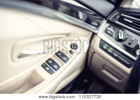 Car Leather Interior Details Of Door Handle With Windows Controls And Adjustments. Car Window Contro