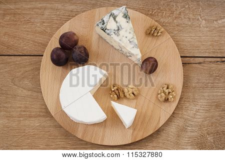 Wooden platter with cheese