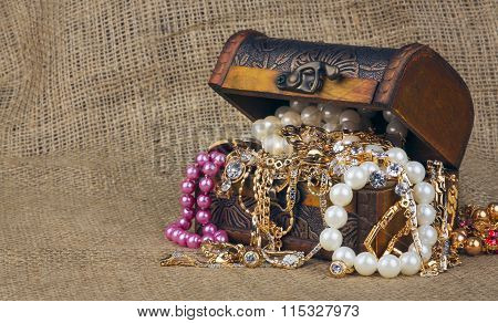 box with jewelry on sacking