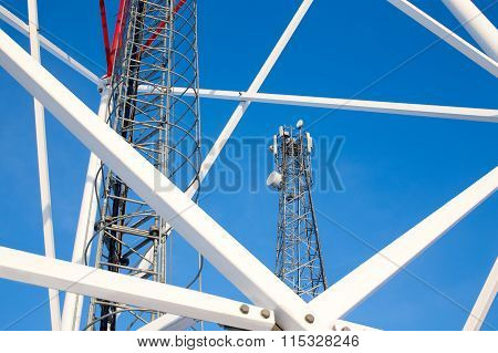 metal construction telecommunications tower against a blue sky