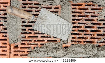 Construction Tools Close-up, Trowel And Putty Knife With Bricks And Mortar And Cement Background