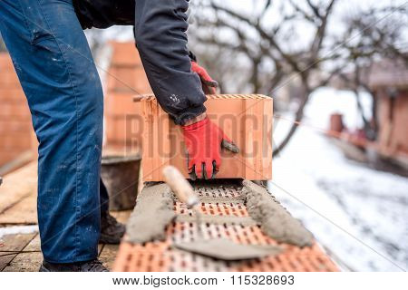 Construction Site And Mason Bricklayer Working With Bricks, Cement And Mortar For Building New House