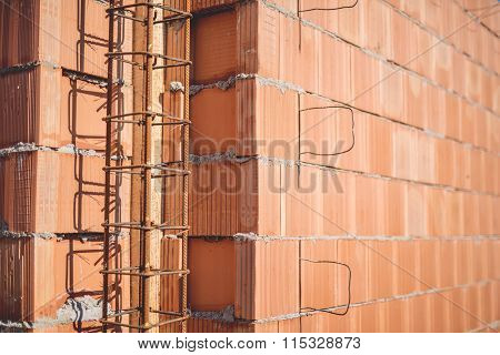 Reinforcement Steel Bars On Pillars, Walls And Layers Of Bricks On New House Construction - Details