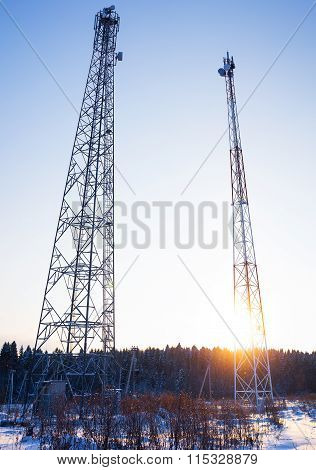 two telecommunications towers in a shot entirely