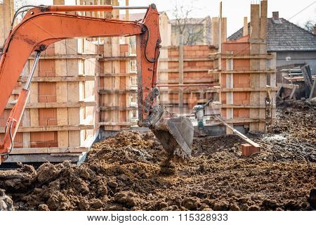 Industrial Truck Loader Excavator Moving Earth And Leveling A Ground Hole