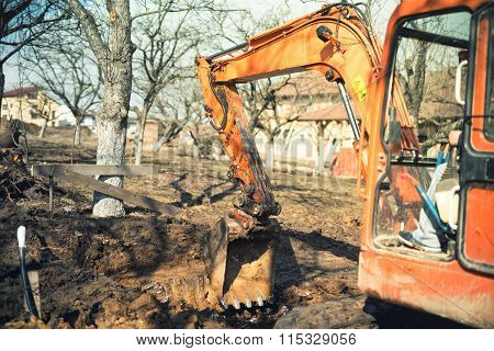Industrial Truck Loader Excavator Leveling Earth And Ground Hole At House Construction Site. Vintage