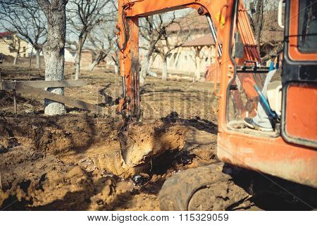 Excavator, Bulldozer And Other Machinery Digging A Foundation Of House At Construction Site