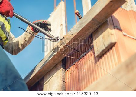 Details Of Infrastructure - Construction Worker Hands Securing Wooden Boards With Wire Rod
