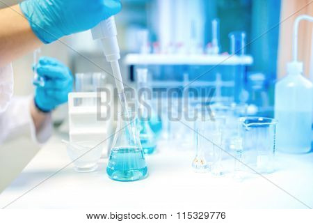 Doctor Using Electronic Pipette For Taking Samples From Test Tube In Special Chemical Laboratory