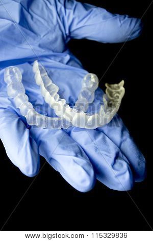 Invisible Dental Braces On Hand