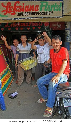 people are welcoming to someone outdoor in Jakarta, Indonesia