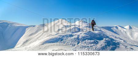 Tourist on a snowy ridge