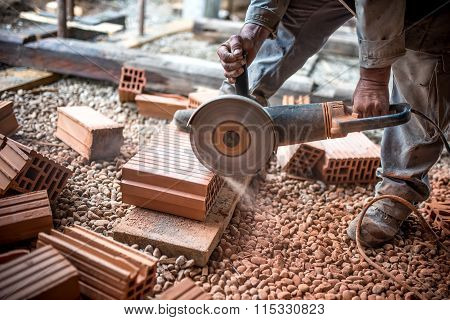 Industrial Engineer Working On Cutting Bricks At Construction Site, Using A Grinder