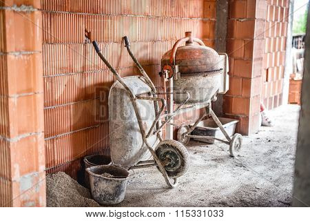 Cement Mixer Machine, Wheel Barrow And Other Construction Site Tools After Working Hours