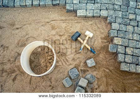 Construction Of Pavement Details, Cobblestone Pavement, Stone Blocks And Rubber Hammers On Construct
